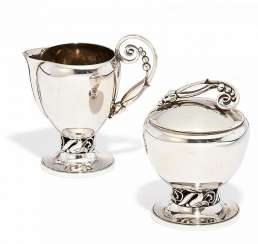 Alphonse La Paglia for Georg Jensen Inc, USA, milk jug and sugar bowl with vegetable tanned decor