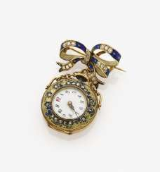 A loop-shaped brooch with a small pocket watch