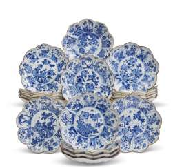A SET OF NINETEEN CHINESE MOLDED BLUE AND WHITE 'LOTUS' DISHES