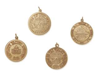 FOUR TIFFANY & CO. GOLD TRAVEL CHARMS