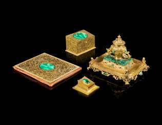 A FRENCH ORMOLU AND MALACHITE AND CABOCHON-MOUNTED DESK SET
