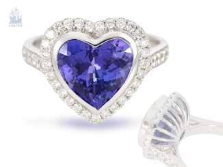 Ring: very high-quality gold-wrought ring with a beautiful heart tanzanite and fine diamonds, never worn from a business resolution