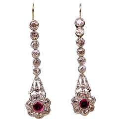 ART NOUVEAU DROP EARRINGS WITH NUMEROUS BRILLIANT-CUT DIAMONDS AND WITH A RUBY OCCUPIED