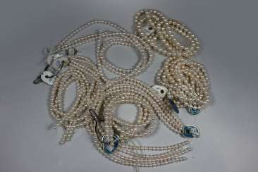 about 19 strands of cultured pearls, white
