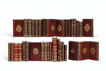 ARMORIAL BINDINGS – a group of 25 works in red morocco armor...