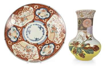 Imari round plate and porcelain vase with flowers decor