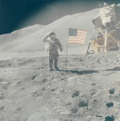 Saluting the flag: Astronaut David Scott performs military salute beside American flag and lunar module