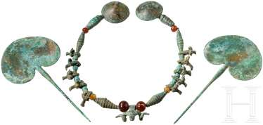 Two needles and a necklace made of Bronze and carnelian beads, Koban culture, 9th - 7. Century before Christ