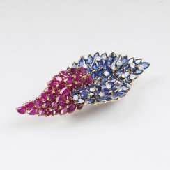 Outstanding Vintage brooch with rubies, diamonds and natural sapphires.