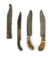 Three short daggers, 'piha kaetta', two of which have ivory handles and silver mountings