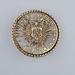 Coin shaped brooch