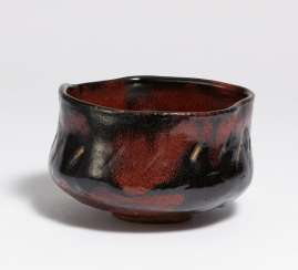 Large tea bowl (chawan) in red-black raku