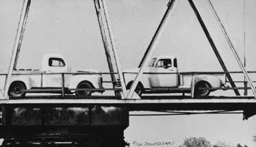 Two Trucks/Two Decisions (on bridge) 1996