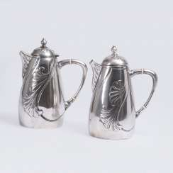 Pair of Art Nouveau pitchers with lotus blossom relief decoration