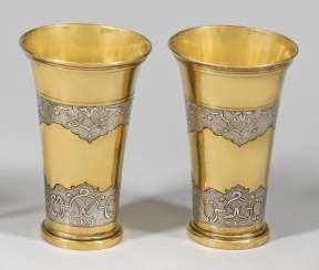 Pair of baroque style mugs