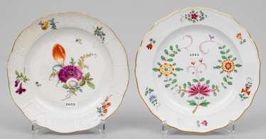 Two decorative plates with floral decor