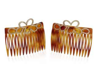 PAIR OF DIAMOND AND GOLD HAIR COMBS