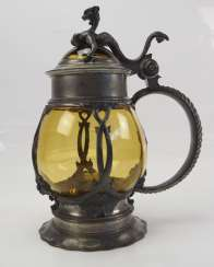 Glass jug with pewter socket.