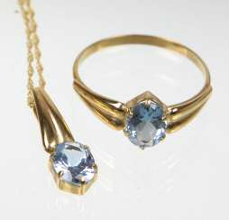 Ring & pendant with blue stone yellow gold 333
