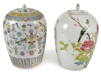 Two lidded vases with Famille rose decor of Antiques, flowers and birds