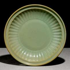 Round bowl with celadon-colored glaze, and passig, ribbed wall