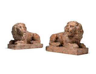 A PAIR OF ROSSO VERONA MARBLE RECUMBENT LIONS