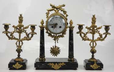 Mantel clock with pair of candlesticks.