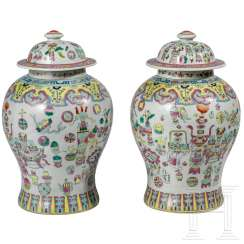 A pair of lidded vases with a six-character mark, China, 19th century
