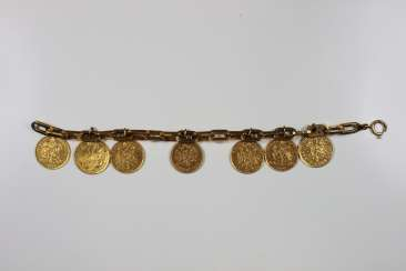 7 gold coins of gold bracelet, total weight: ca 32 gr.