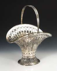 Large silver basket with glass insert.
