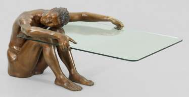 Coffee table with bronze figure