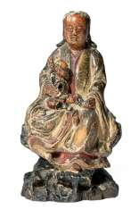Polychrome ducted wood figure of Guanyin with child