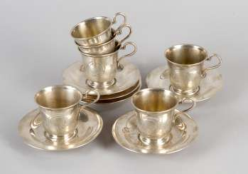 Six silver cups and saucers