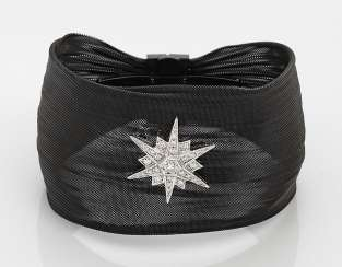 Cuff bracelet with diamond star