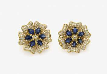 A Pair of clip earrings in the Form of a flower with sapphires and diamonds. Probably Germany