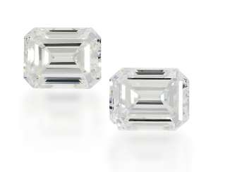 Diamond: Pair of fine Emerald Cut diamonds, 0.52 ct and 0.54 ct, River-Top Wesselton/VS, with the current DPL certificates