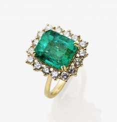 Entourage ring with a Colombian emerald and diamonds, Belgium, 1980s-1990s