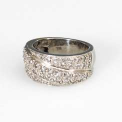 Wide band ring with brilliant-cut diamonds.
