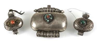 Three amulet cans, some in silver or copper, among other things coral/turquoise trim