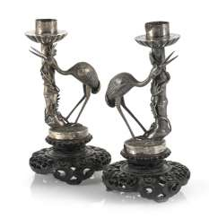 Pair of candlesticks made of silver in bamboo form with a Heron ornament