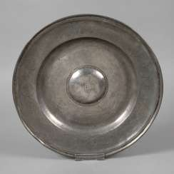 Big tin plate with a curved middle piece