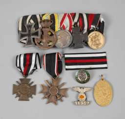 Mixed lot of medals and badges of both world wars
