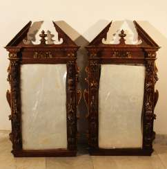 Pair of French mirrors in manieristic manner with roof top and rich figural and ornamental carvings on all sides, partly gilded
