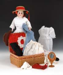 Chest head doll and sewing box with clothes.