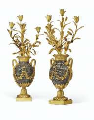 A PAIR OF FRENCH ORMOLU-MOUNTED MARBLE FOUR-LIGHT CANDELABRA