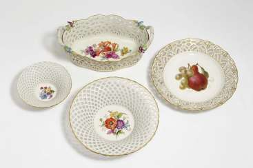 Handle basket, two basket bowls and a fruit plate with a basket rim