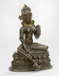 Bronze of a green Tara on a Lotus