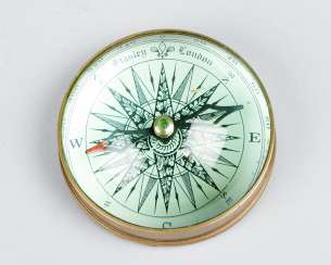 Table compass by Stanley London under glass