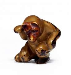Netsuke: Crouching actor, with a Fox mask