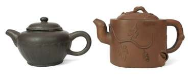 Two Zisha teapots, one with plastic grape vines decor